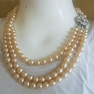 Champagne three strand faux pearls